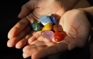Close-up of Chakra stones in woman hand